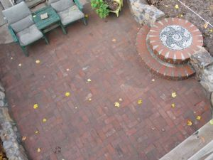Note the dirt/old leaves to the right of the patio.